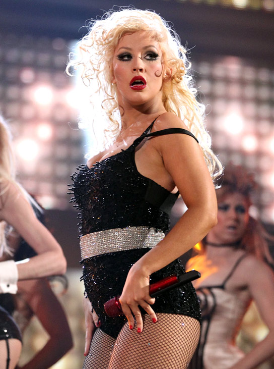 christina aguilera 2011 weight gain. Fame has made her gain weight.